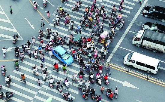 电动自行车威胁道路安全怎么办?两位部长回应