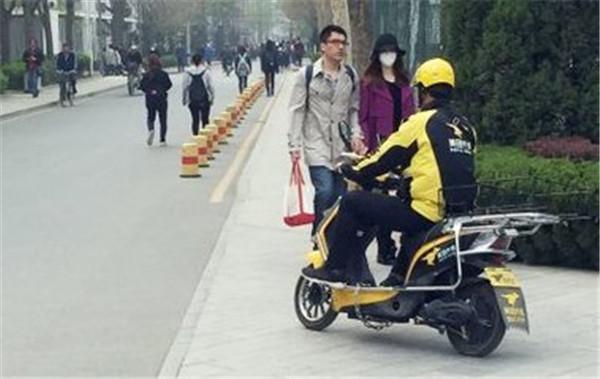 """外卖小哥""""玩命飙车"""" 江苏呼吁率先立法规范电动车管理"""